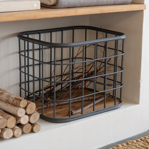 grey metal grid basket with wooden bottom