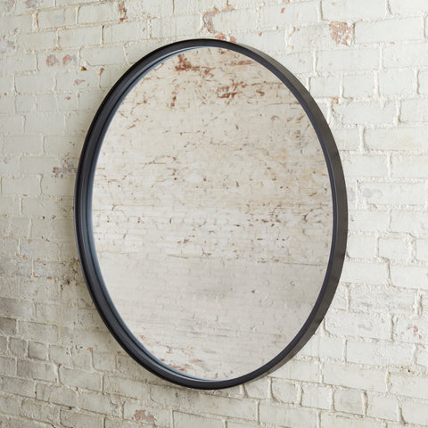 large circle mirror with blackened bronze metal frame