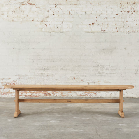 medium toned wood bench with trestle style base