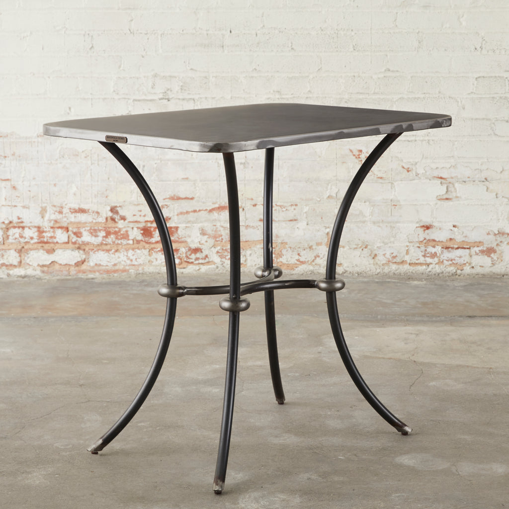 metal side table with stock metal finish and curved legs