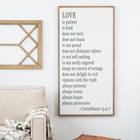 Painted wooden sign that quotes 1 Corinthians 13:4-7 from The Bible