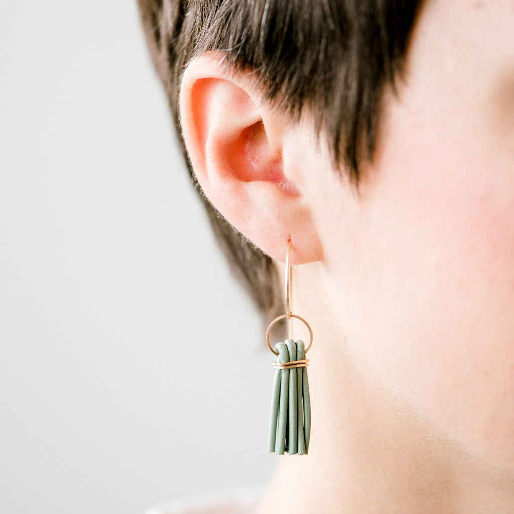 Mint tassel earrings on a woman