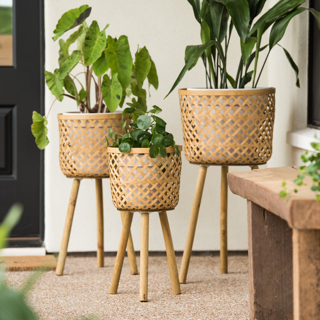 modern basketweave tripod raised plant stand in natural wood color