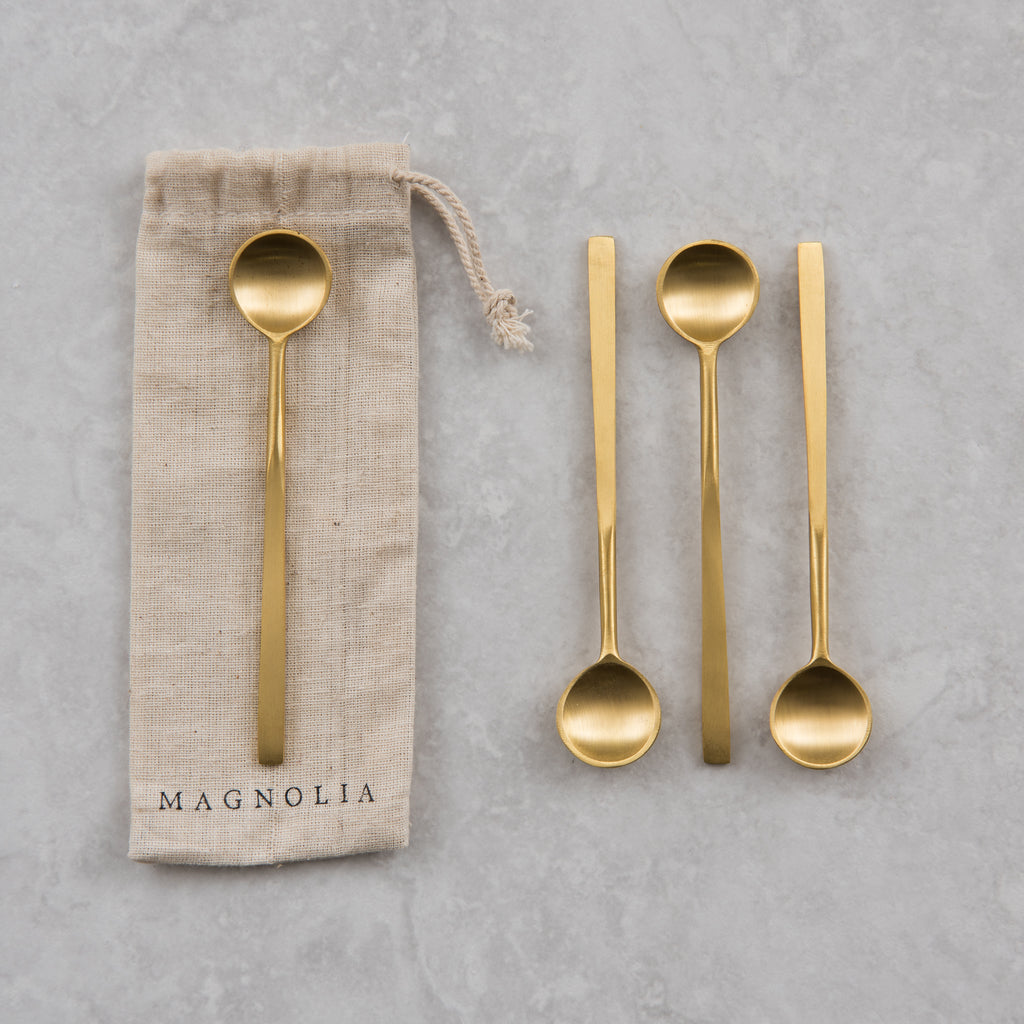 set of 4 brass spoons