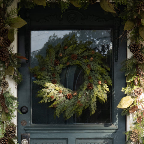 faux pine wreath with pinecones