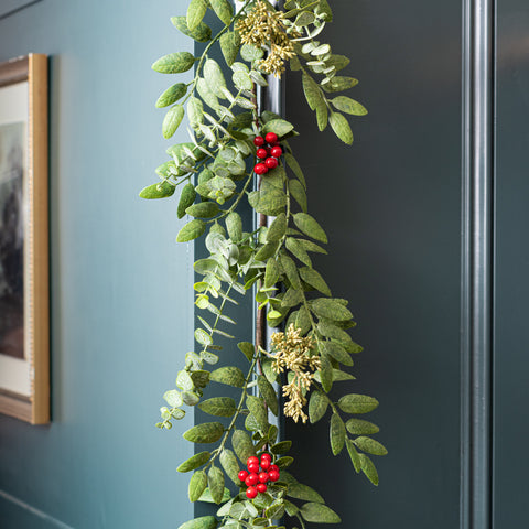 faux eucalyptus christmas garland with red berries