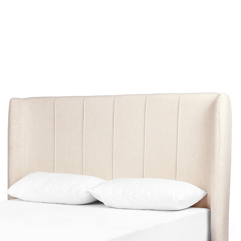 cream padded fabric headboard with vertical stitching