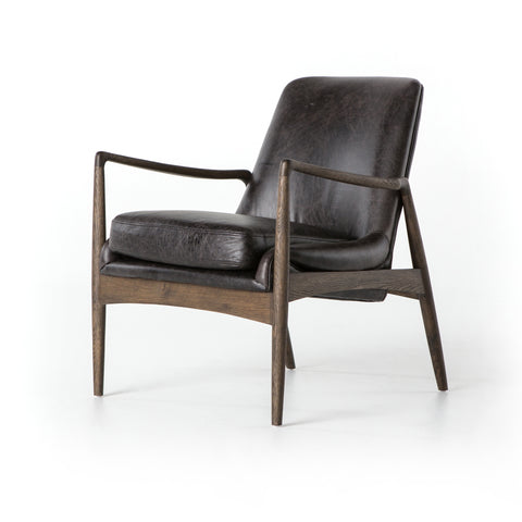 distressed black leather mid century modern arm chair with wooden arms and legs