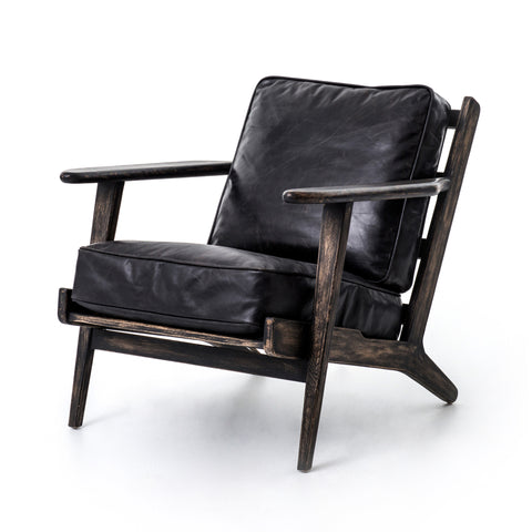 wooden distressed black lounge arm chair with thick black leather cushions