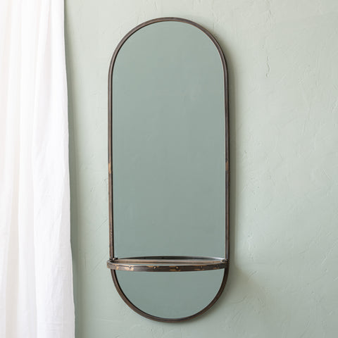 tall oval mirror with metal frame and folding shelf