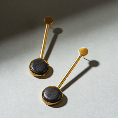 black ceramic and brass pendulum earrings