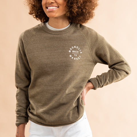 olive green sweatshirt with white circle crest magnolia logo on left chest and full back