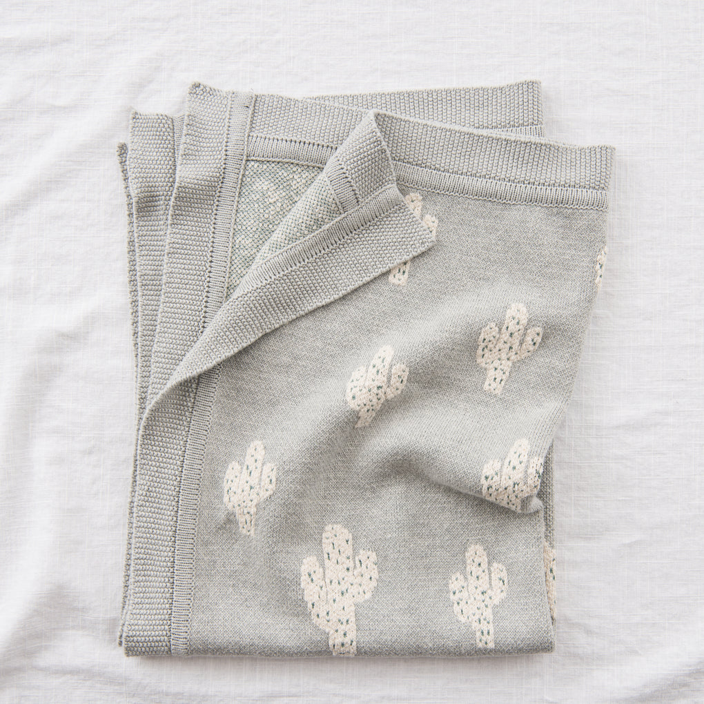 grey baby blanket with white cactus print