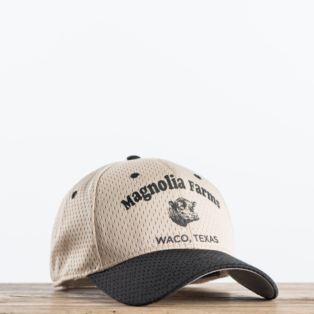 Beige and Black Magnolia farms logo hat
