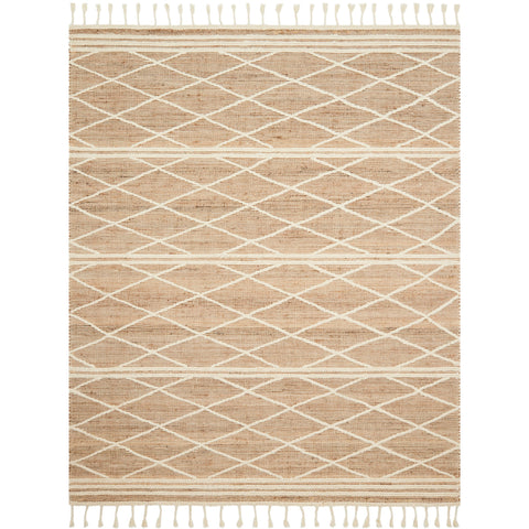 blush moroccan style rug with white diamond patterns and white tassel fringe