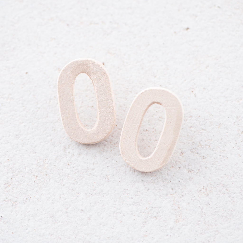 cream ceramic oval hoop earrings
