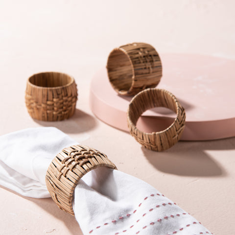 set of four seagrass woven wrapped wooden napkin rings