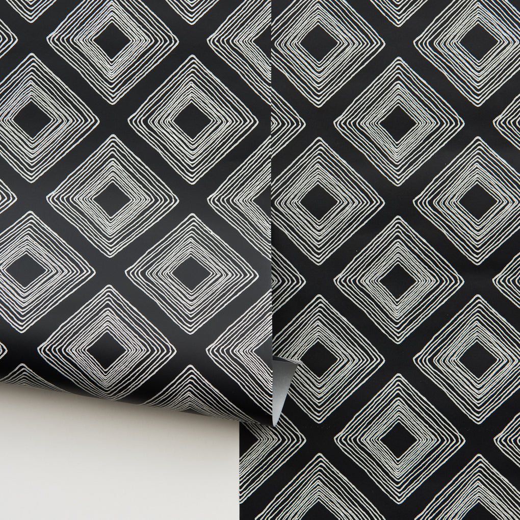 white geometrical diamonds on black wallpaper