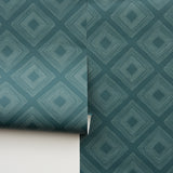 white geometrical diamonds on teal wallpaper