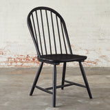 black wooden spindle back dining chair