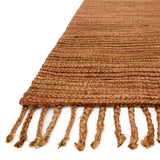 modern rust colored rug with tassels
