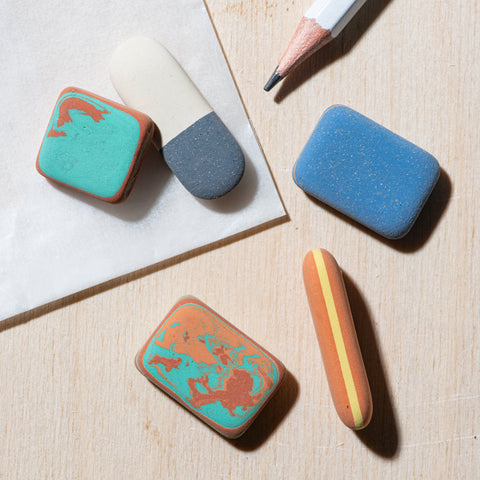 assorted pebble erasers