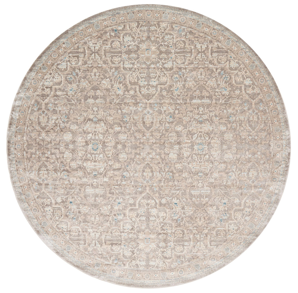 distressed tan circle area rug with cream floral detail