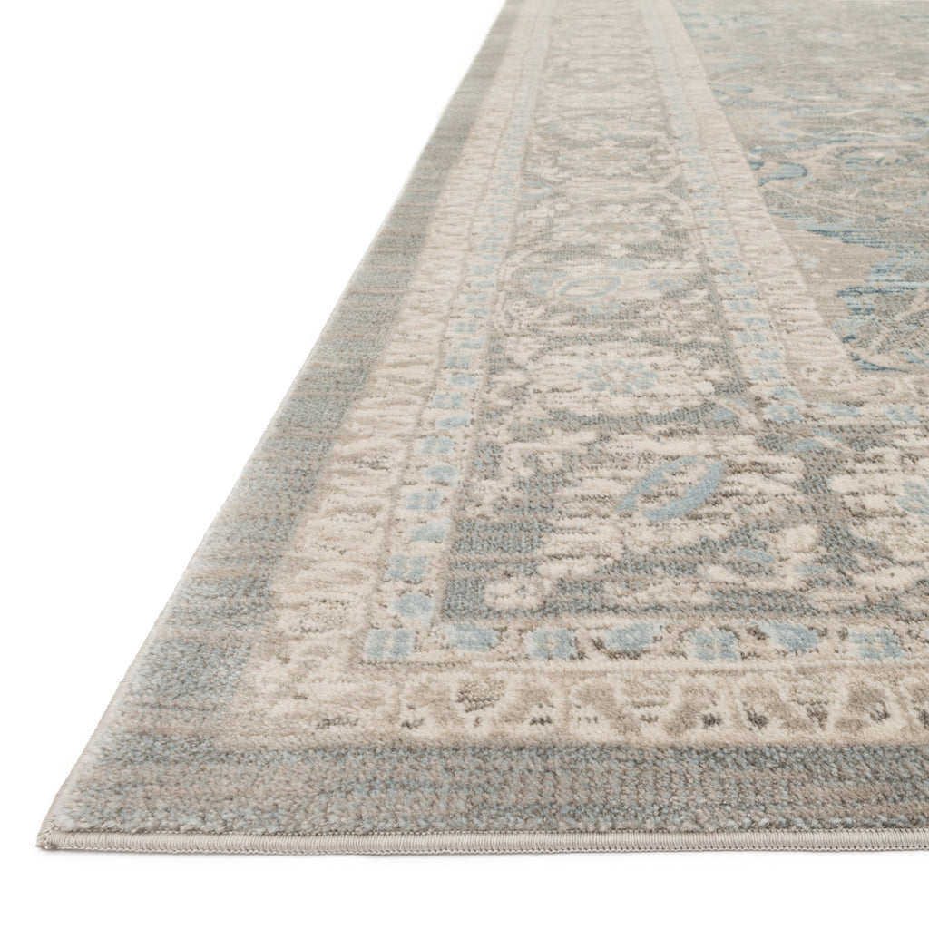 distressed traditional beige area rug with light floral detail
