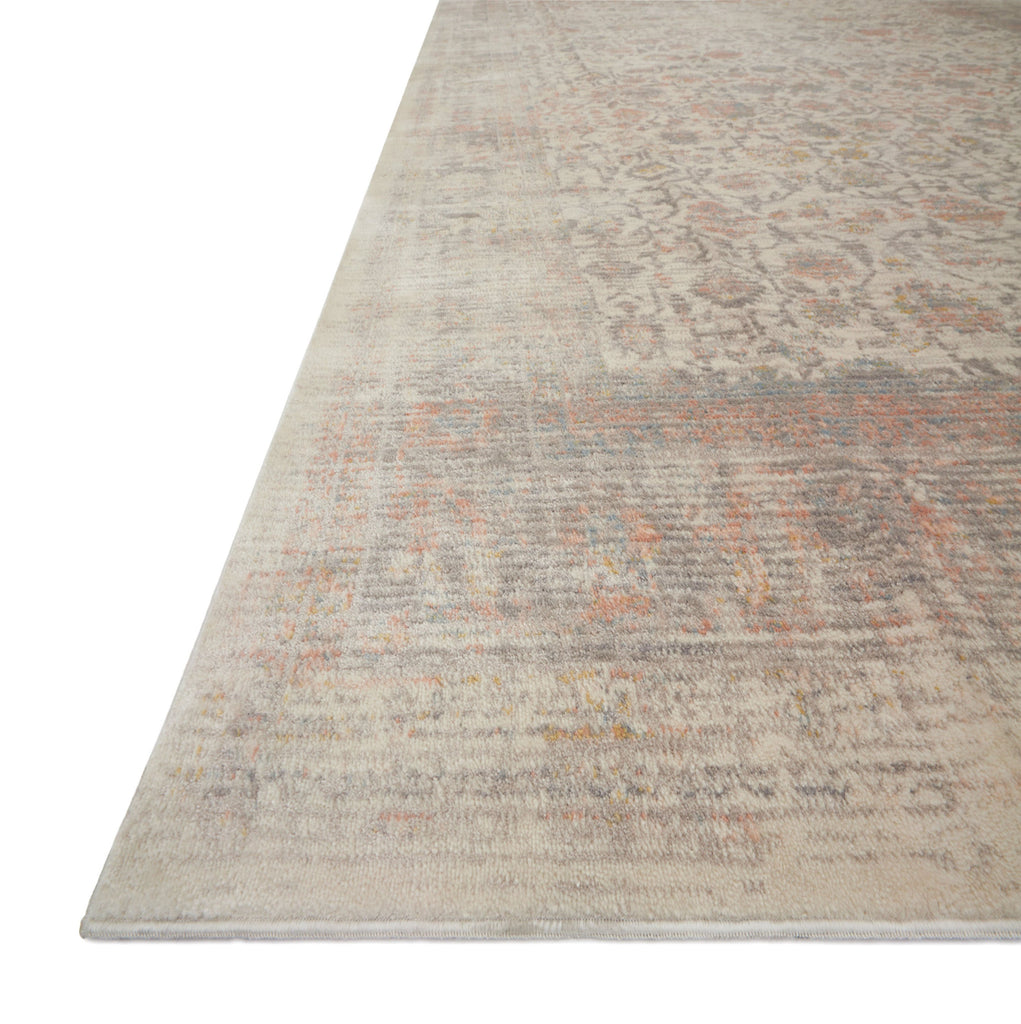 distressed ivory rug with muted red and blue details