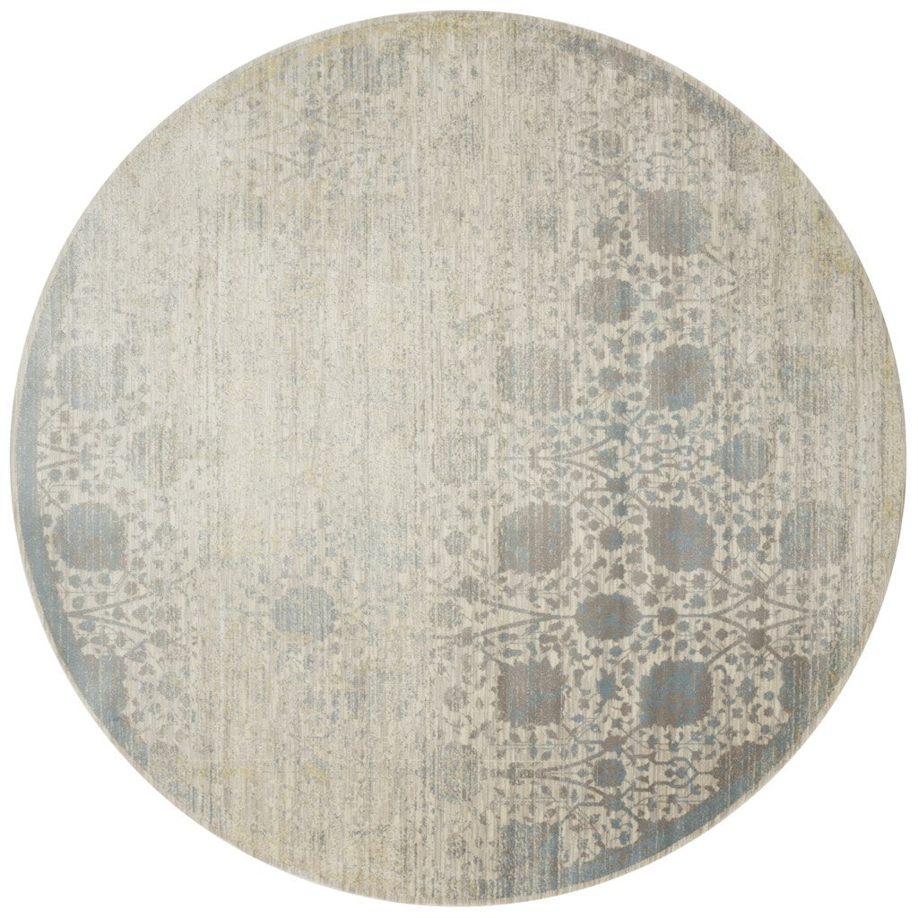 distressed beige and light blue circle rug with floral pattern