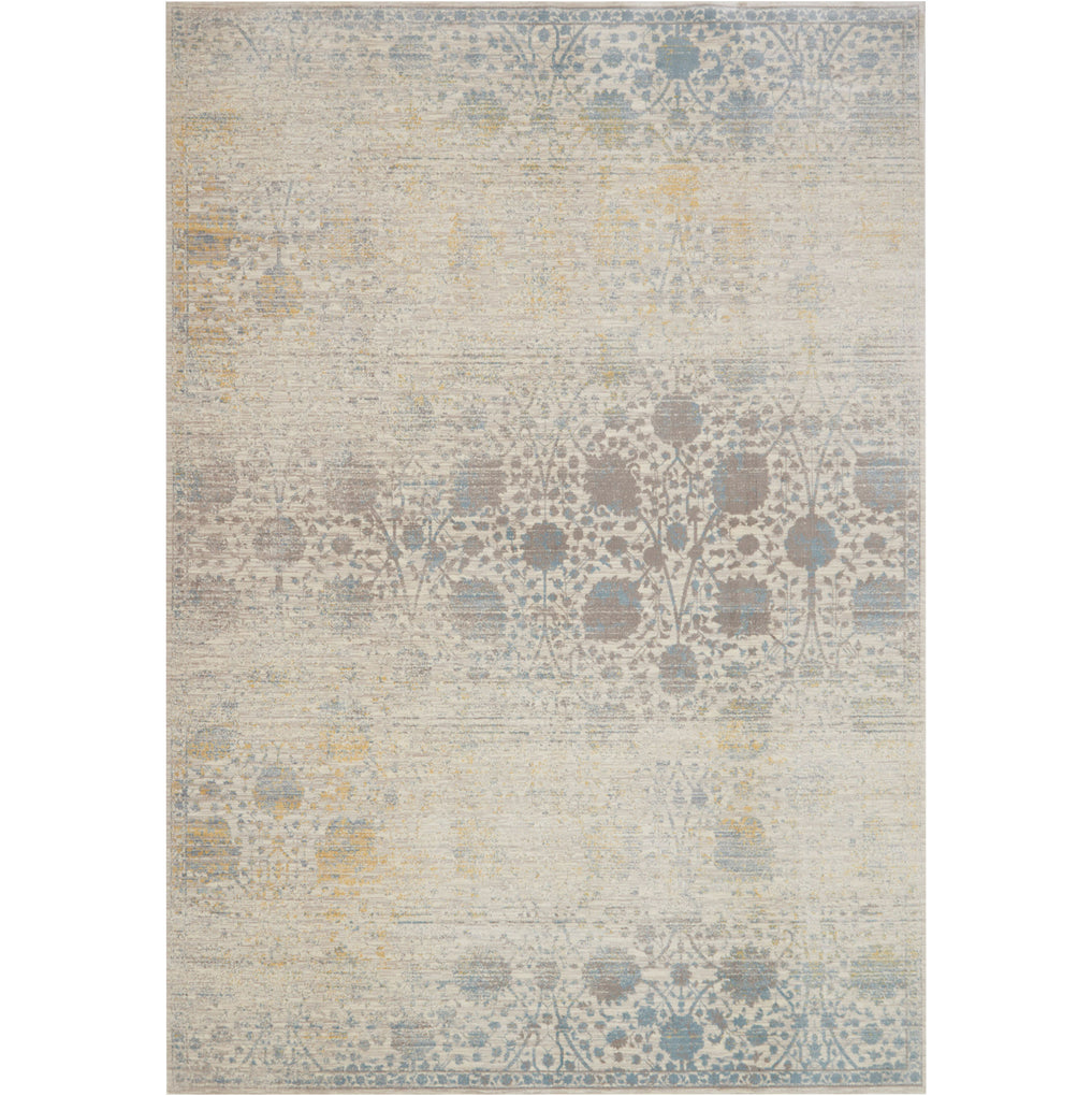 distressed beige and light blue rug with floral pattern