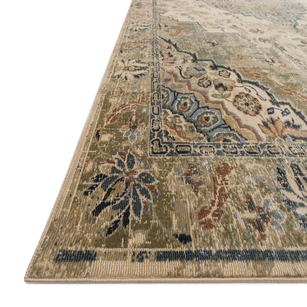 synthetic wool distressed rug that is muted green and cream