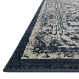 dark indigo traditional rug with white floral detail