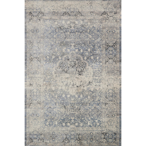 medium blue-grey distressed rug with floral pattern