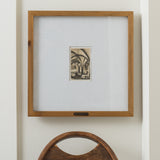 stained wood photo frame with white mat