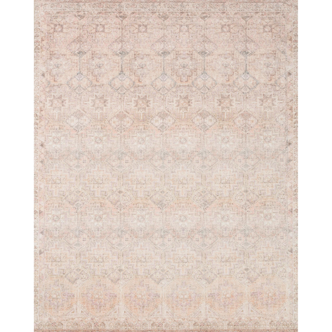 beige-blush distressed area rug with faded southwestern detail
