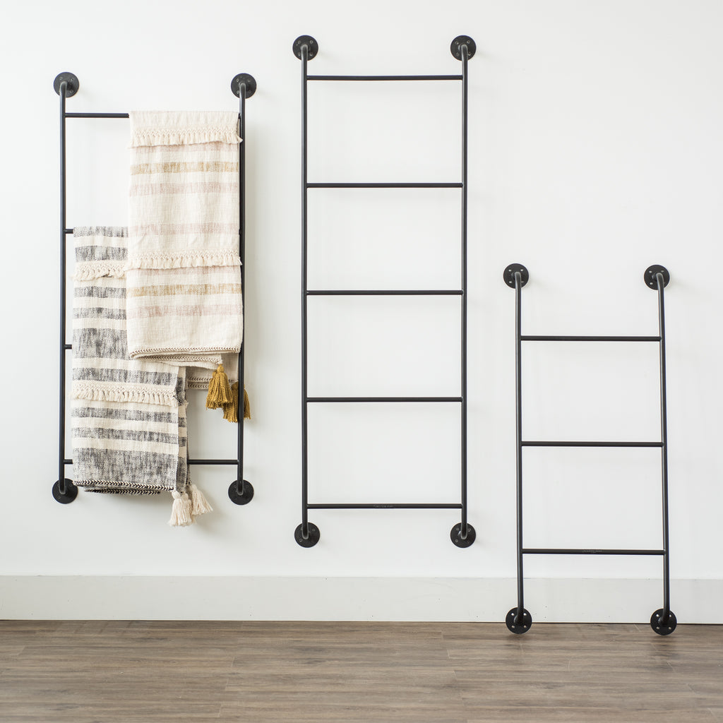 tall black metal wall display ladder