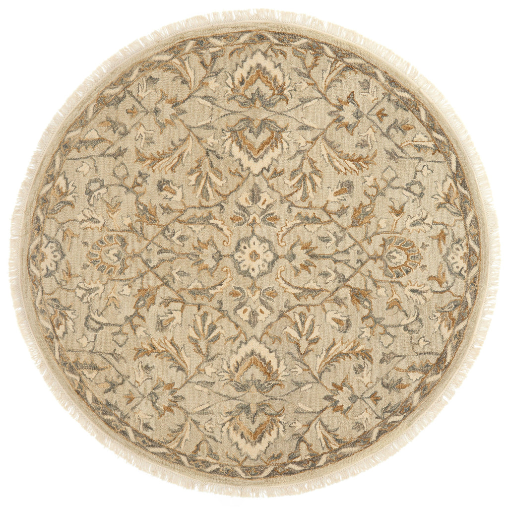 traditional tan circle rug with floral detail