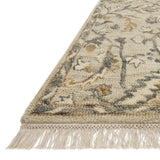 traditional tan rug with floral detail