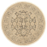 traditional tan circle rug with floral detail and dark grey undertones