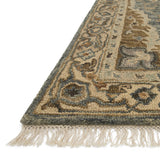 traditional beige rug with tan floral detail and slate blue detailed medallion