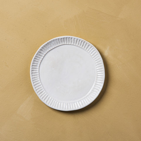 cream ceramic pleated edge plate