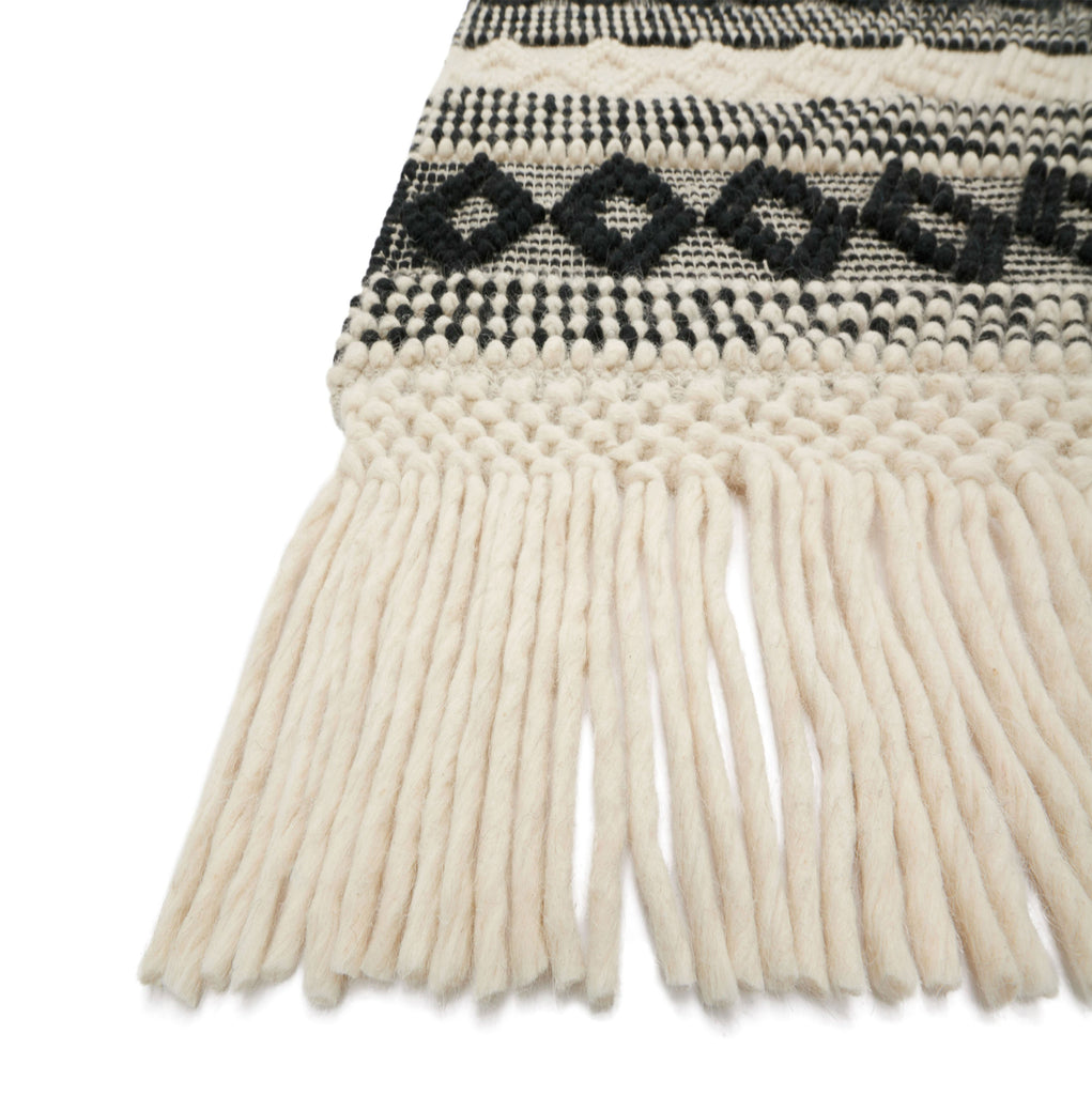 modern black and white diamond pattern rug with white tassels