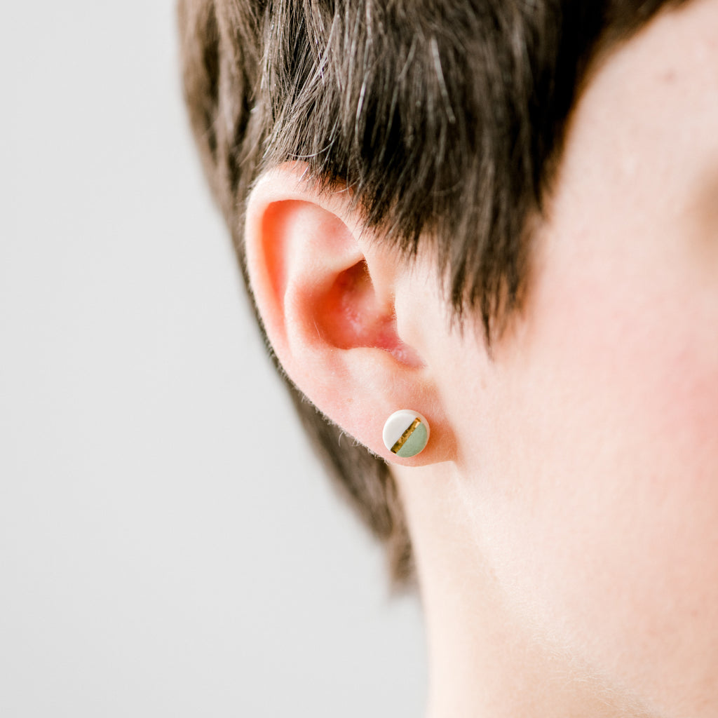 Moss and White Earrings on a Woman
