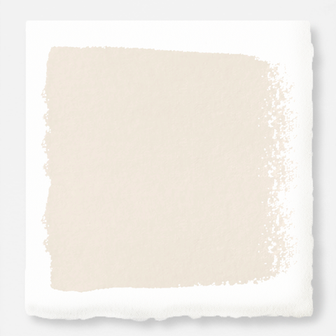 An ivory shade dusted with pink and yellow chalk style paint