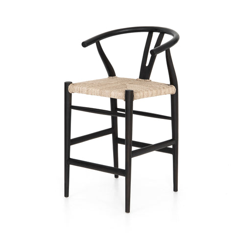 black wooden counter stool with curved back and woven seagrass seat