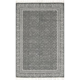 dark grey modern rug with ivory detail and tassels