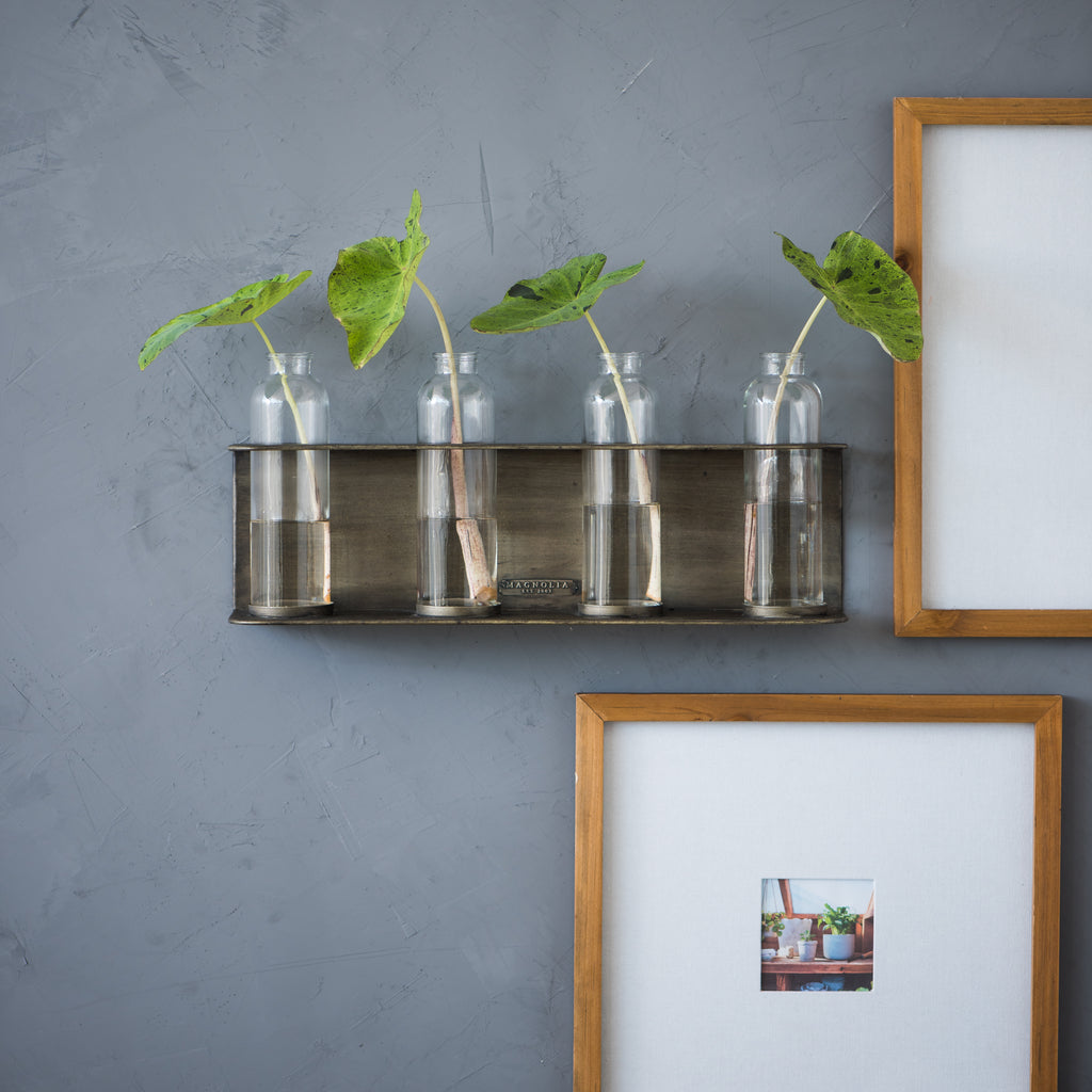 black metal wall vase holder with four glass vases