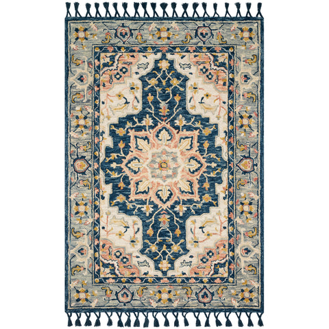 ORNATE RUG WITH BLUE BASE AND PINK DETAIL WITH TASSELS