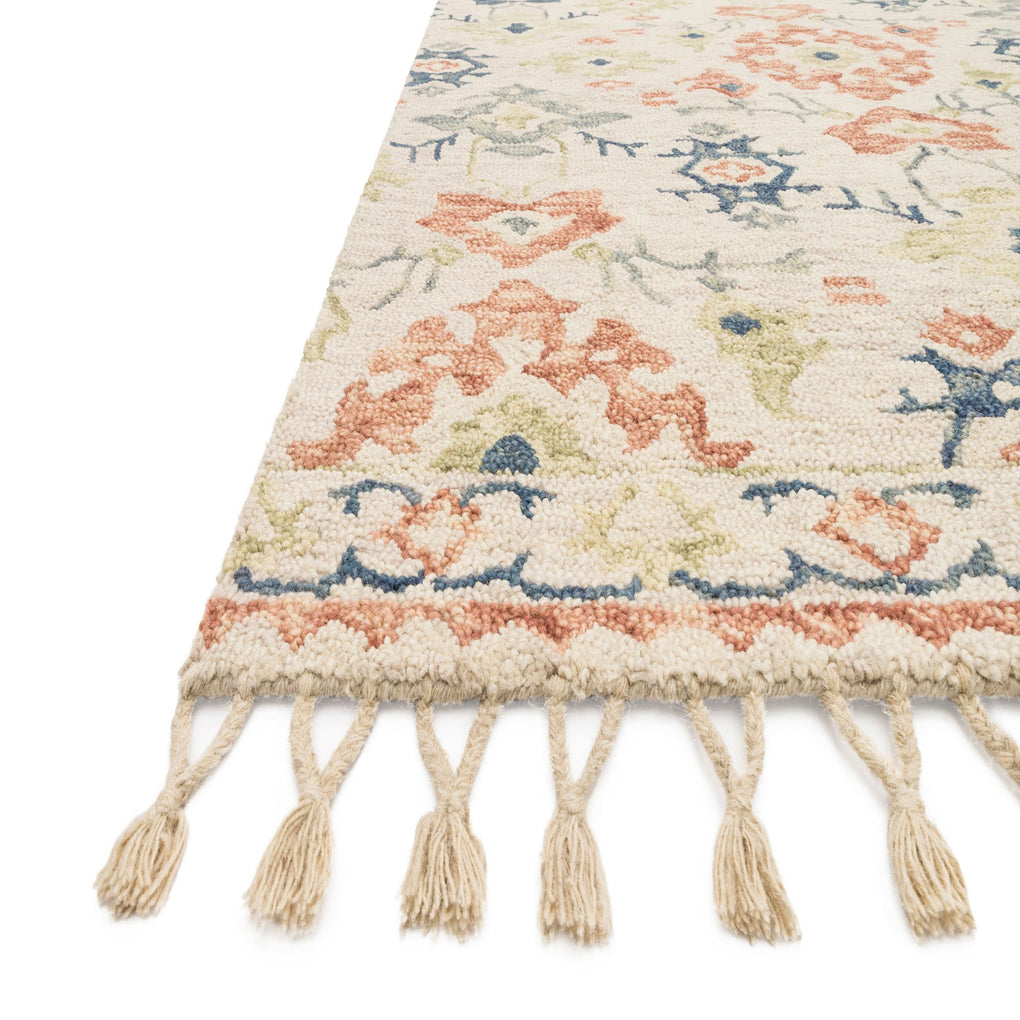cream based rug with orange and blue accents